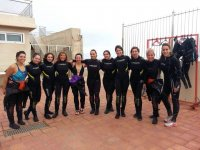 Groups of women with diving equipment