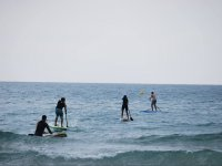 Entering the sea to do sup in group