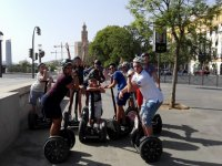 On segway in front of the Torre del Oro