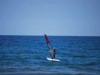 Windsurfer entering at sea