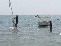 Soleil, plage et planche à voile