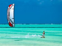 kite surfing in the sea on windy day