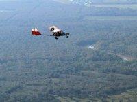 ultralight in flight over the field