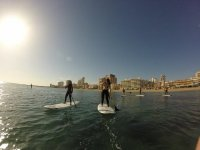 Paddle surfing with friends