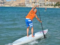 Practicing paddle surfing