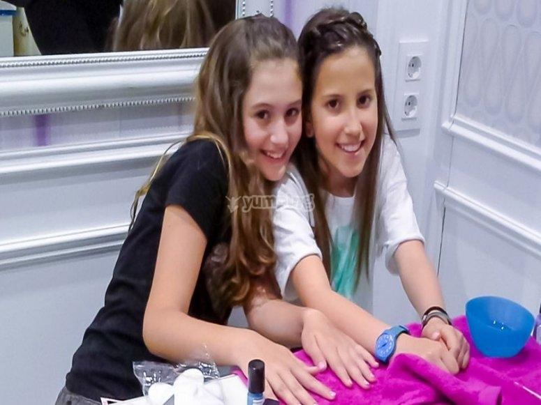 Two girls enjoying a manicure session