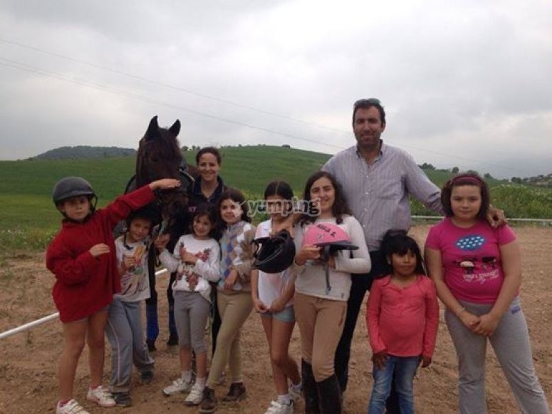 Horseback riding students