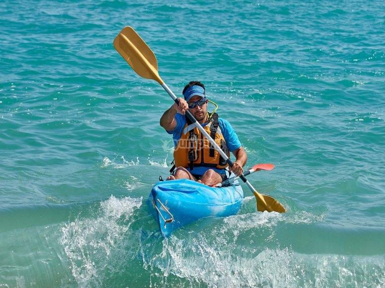 Remando en la orilla de Tamarit