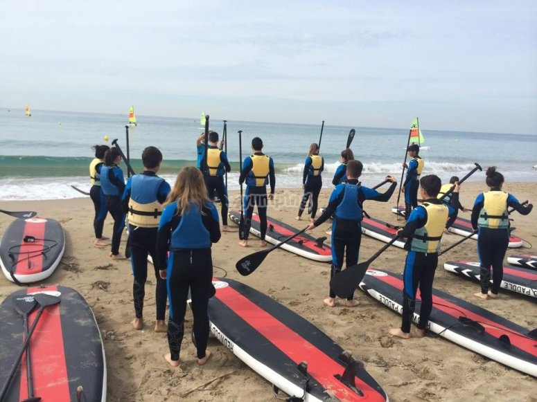 Group trip with paddle surf boards