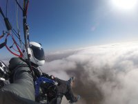 In a paraglide over the clouds