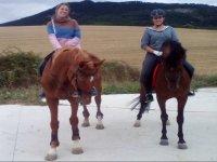 Horse riding through Ezcaba Valley