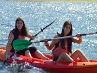 Friends on board the kayak