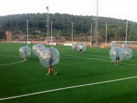 Bubble soccer players in play