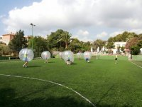 Bubble football match on grass