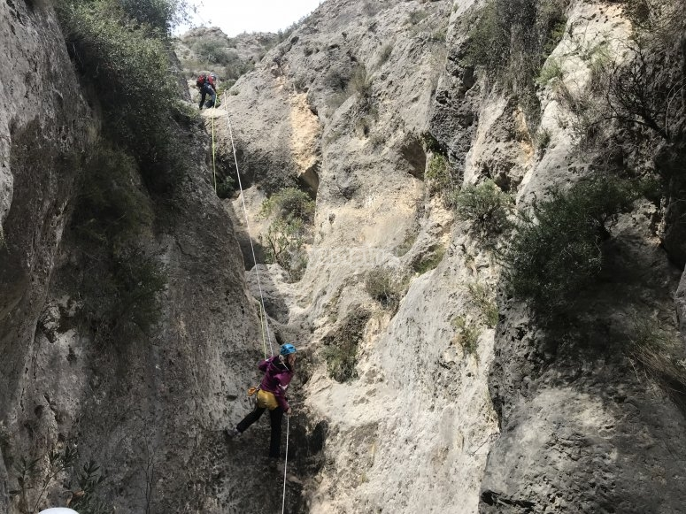 Descending the dry canyon