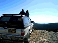 couple enjoying the views in the 4x4