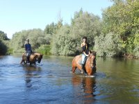 Crossing the river on horse