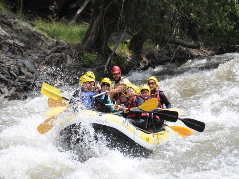 Paddling through the river rapids