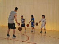 practicing basketball in our language camp