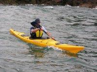 Paddling in yellow canoe