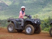 In quad with helmet and glasses