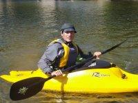 man in a yellow individual kayak