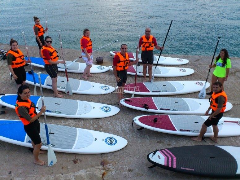 Grupo de alumnos de paddle surf