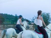 Young riders on the white horses