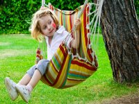 A girl enjoying the swing