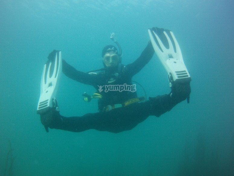Diver touching his fins