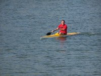 Paddler in action aboard the kayak