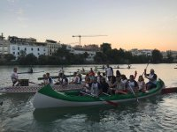 On board the canoes in Seville