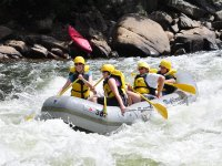 Paddling in a rapid with the raft