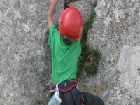 Boy with red helmet climbing