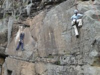 A man and a woman practicing climbing