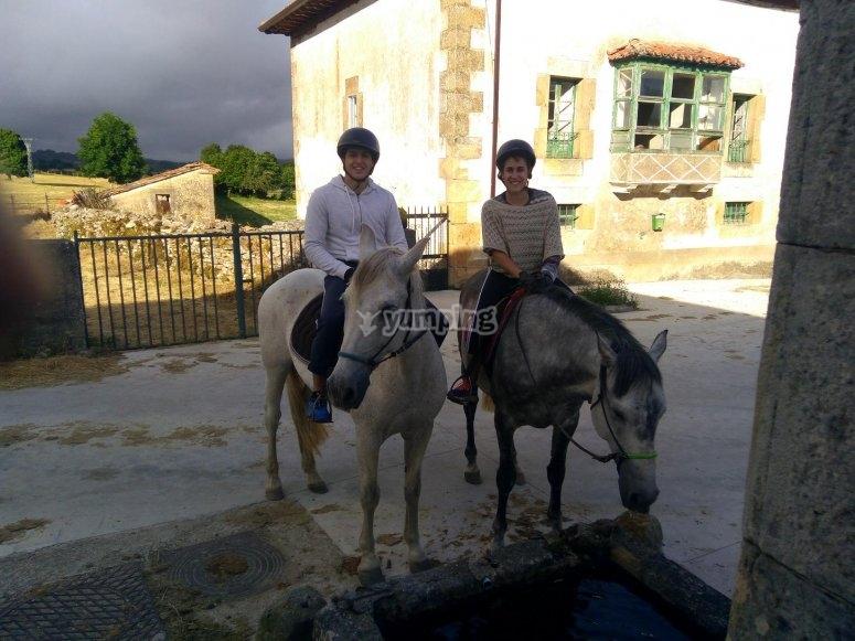 Riding the horses through the village