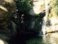 Couple jump to the ravine