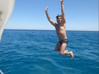Jumping into the water from the boat