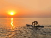 SUP Yoga at sunset