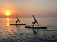 Yoga SUP al tramonto
