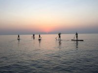 Percorso paddle surf al tramonto