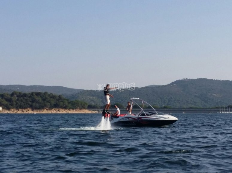 Flyboarding by the speedboat