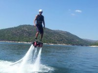 Flyboarding while wearing a safety helmet