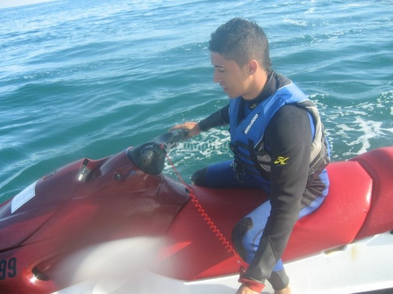 Riding a jet ski with a neoprene suit