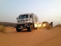 Truck rally through sand