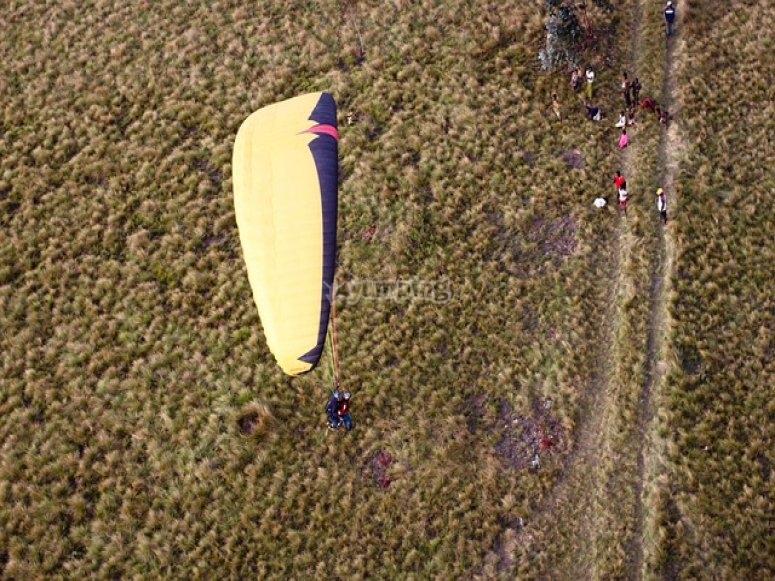 Bird's-eye paragliding view while landing