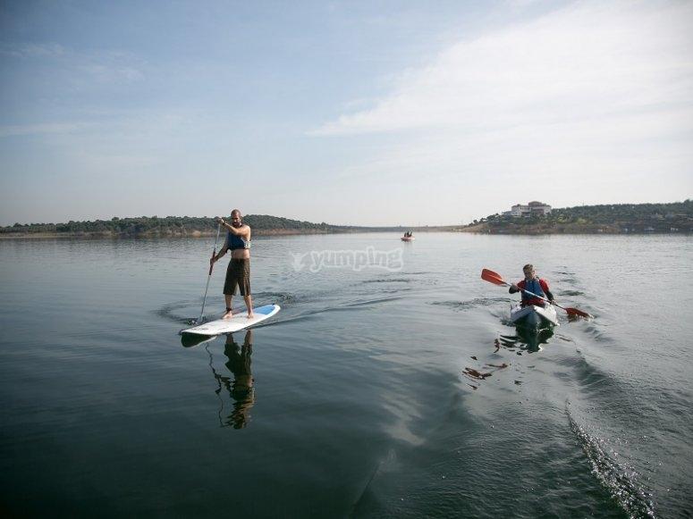 Paddle surf near the kayak