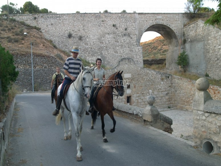 On horseback near the bridge