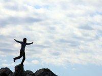 woman climbing to rock