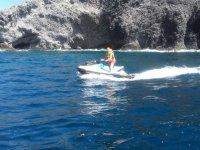 Riding a jet ski along the cliffs of Mar Menor